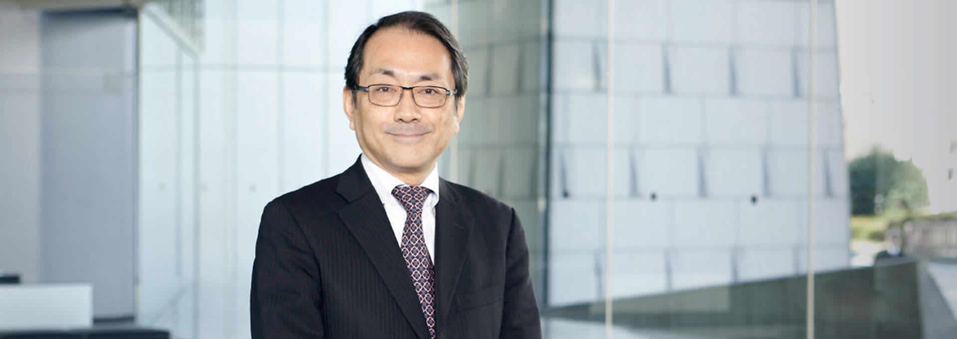 ประธานกรรมการ - Eiji Arai